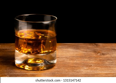 whiskey glass and whiskey