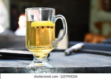 whiskey glass with cloves and lemon.  Hot Irish Whiskey.