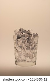 Whiskey glass filled with icecubes still life