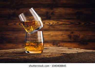 Whiskey glass on the old wooden table
