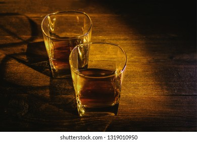 whiskey in a glass on an old wooden table