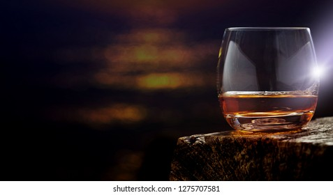 Whiskey, whiskey glass on the wooden table.