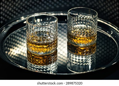 Whiskey glasses on the tray.