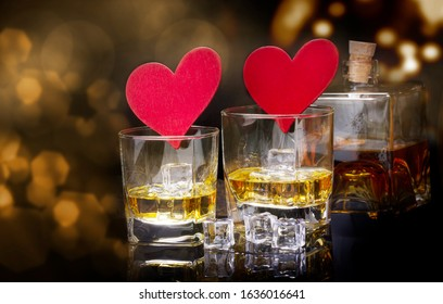 Whiskey and hearts against bokeh, clinking glasses for Valentine's Day