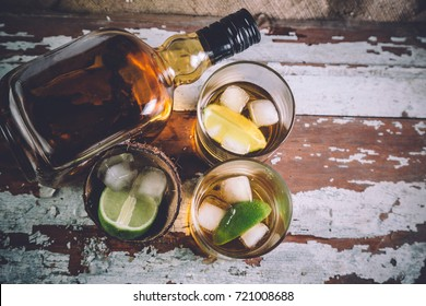 whiskey with ice, a bottle of rum tequila...