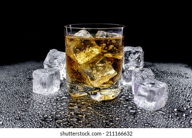 Whiskey with ice, isolated on black