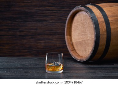 whiskey with ice on a wooden table on a  black wooden table