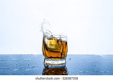 whiskey with ice splash