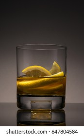 Whiskey with lemons in a glass