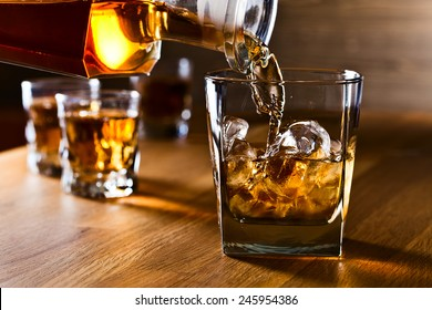 whiskey and natural ice on old wooden table