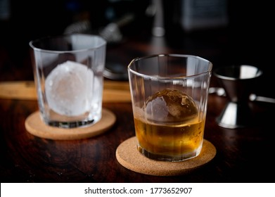 whiskey on the rock with perfect ice ball