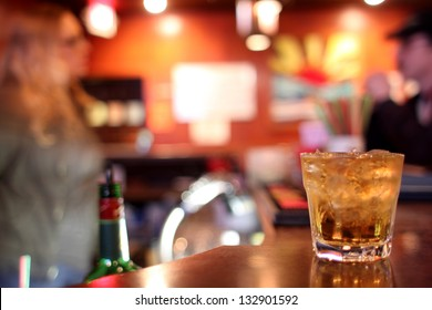 Whiskey on the rocks at a dive bar.