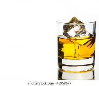 whiskey on the rocks on white with reflection