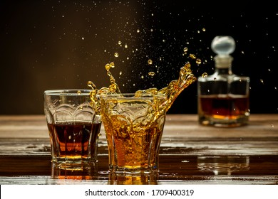 whiskey on the table with a splash in the glass, strong alcoholic drinks
