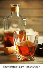 Whiskey on wooden background