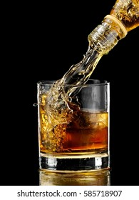 Whiskey pouring in a glass