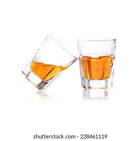 Whiskey in a shot glass isolated on a white background