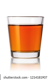 whiskey in small shot glass isolated on white background