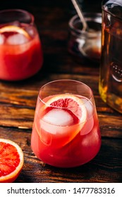Whiskey sour cocktail with aged bourbon, blood orange juice and simple syrup