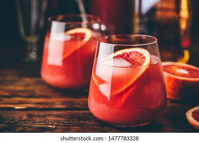 Whiskey sour cocktail with aged bourbon, blood orange juice and cherry syrup
