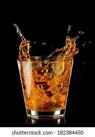 Whiskey splash from a glass