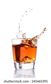 Whiskey splash in a glass  isolated on a white background