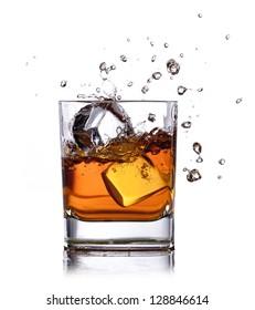 whiskey splash with ice cubes isolated on white
