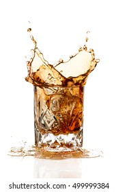 Whiskey splash on elegant glass of cut glass isolated on white background with copy space