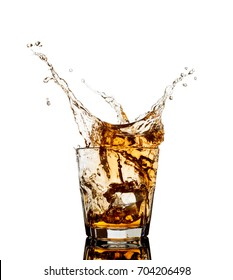 Whiskey splash out of glass isolated on white background