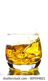 whiskey splashing in glass