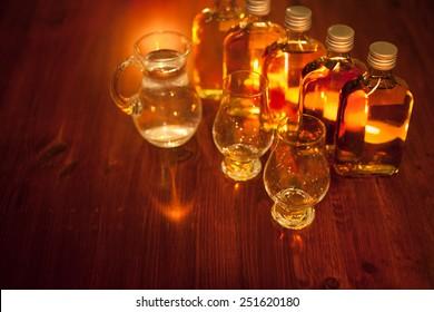 Whiskey tasting: sample bottles, glencairn glasses and a jug of water