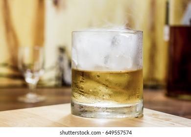Whiskey tumbler and ice Medium shot