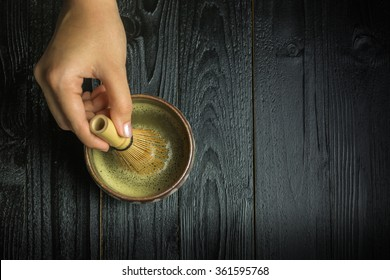 Whisking matcha powder by a chasen