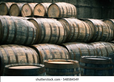 Whisky barrels full of whiskey in Scottish traditional distillery