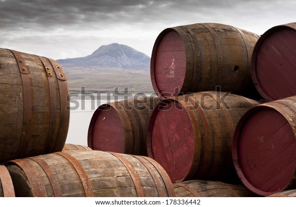 Whisky Barrels on Islay/View over to Jura/Whisky barrels stacked up