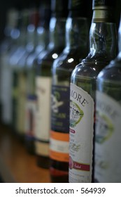 Whisky bottles in a row, partially blurry
