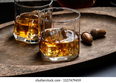 Whisky or bourbon with ice on the rock style in glass dark background . concept bar whisky .