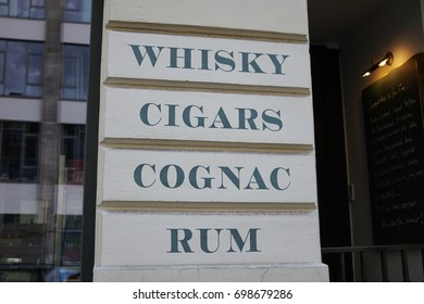 Whisky, cigars, cognac and rum signage outside a shop