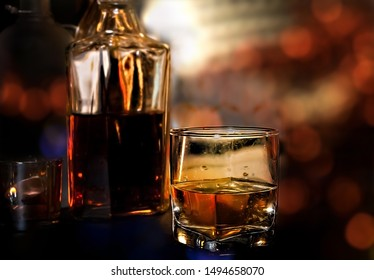 Whisky In A Glass. Light Bokeh Background. Out Of Focus.