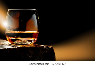 Whisky, whisky glass on the wooden table