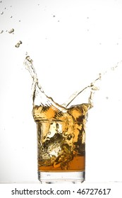 Whisky and ice. Brown brandy with splashing