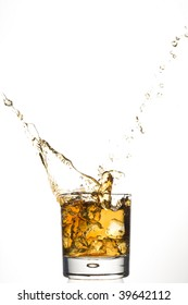 Whisky and ice. Brown scotch