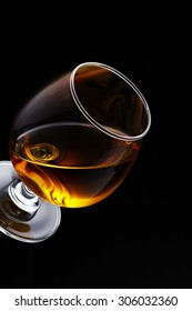 Whisky on glass isolated on black background