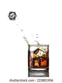whisky splash and ice  isolated on a white background