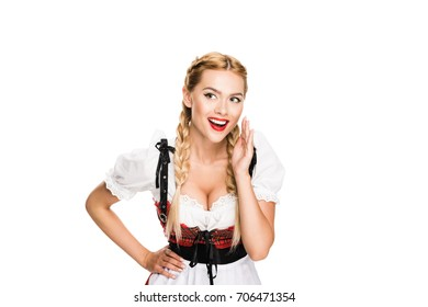 Whispering beautiful girl in traditional german costume, isolated on white