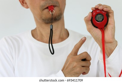 Whistle and Stopwatch on white background, sport competition, referee, time catcher, winner, looser, statistics, winning spirit concept