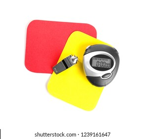 Whistle, stopwatch, red and yellow cards on white background, top view. Football rules