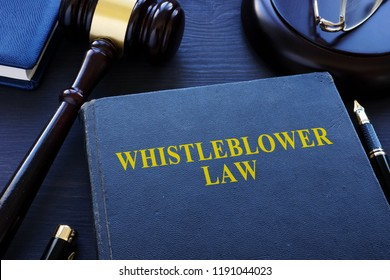 Whistleblower law book and gavel in a court.