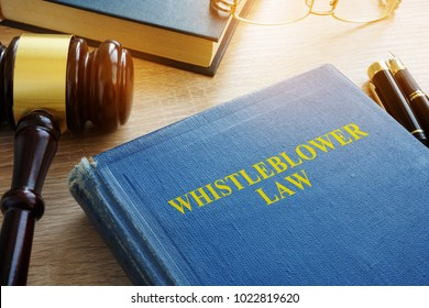 Whistleblower law on a court desk.
