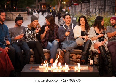 Whistler BC, Canada - September 18th, 2015:  A group of friends at a fireplace booth at a Whistler restaurant.